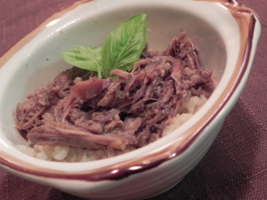 Pork and rice in a bowl.