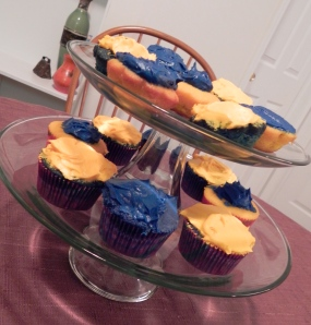 Maize and blue cupcakes