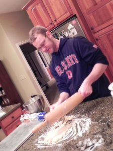 Ben rolling out cookie dough