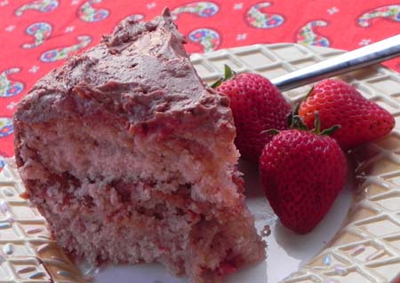 Fresh strawberry cake from scratch... no Jello, artificial flavorings, or anything fake! This cake is delicious and easier than you would think! Top it with a rich chocolate frosting and you have Chocolate Covered Strawberry Cake that everyone will want an extra slice...or two...or three of!