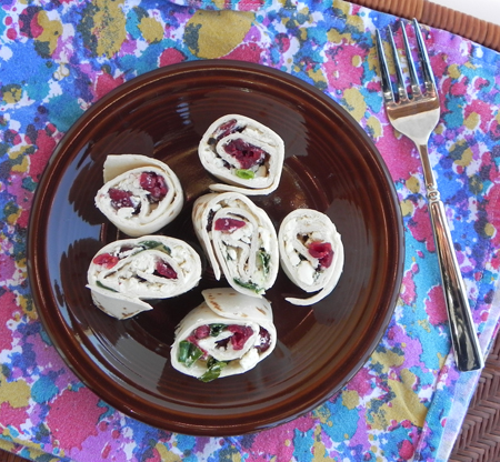 Cranberry Feta Pinwheels are fuss-free and amazing. They should be made ahead so that their flavors have a chance to meld, and so their sweet, tangy, creamy, and salty nature can shine through.