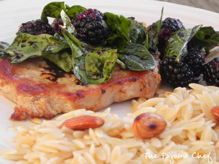 close up of Pork Chops with Balsamic Blackberry Salad + Orzo on a plate