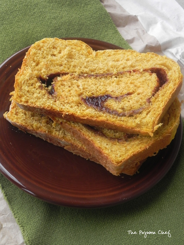 Pumpkin Cinnamon Swirl Bread - soft, fluffy cinnamon swirl bread made with fall's favorite flavor! via thepajamachef.com #pumpkin #recipe #bread #baking