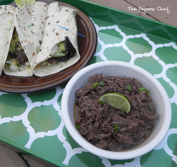Crockpot Barbacoa - an easy way to fancy up your next taco night! Find the recipe on thepajamachef.com #secretrecipeclub #src