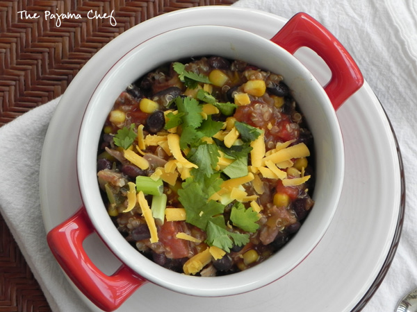 Crockpot Chicken Quinoa Chili: Quinoa meets chicken tortilla soup for a kicked up crockpot meal that is filling, delicious, and perfectly spiced. Plus, you can top it with everything from tortilla chips to cheese to avocado so it's a customized dinner that your whole family will love!