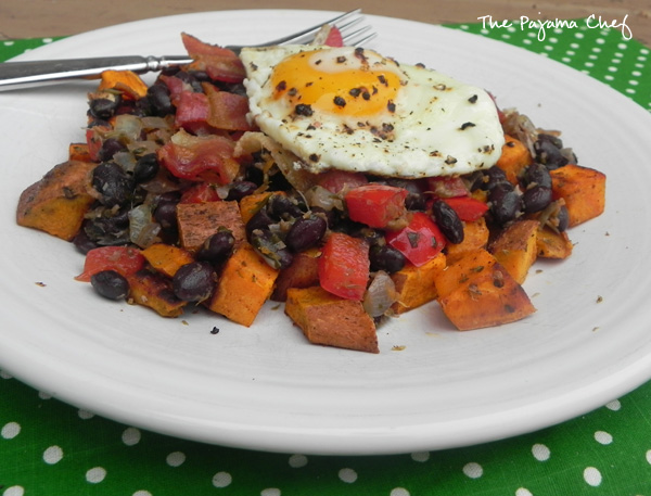This sweet potato hash combines pretty much all my favorite things... sweet potatoes, black beans, red peppers, bacon, and fried eggs. Ginger and grapefruit zest give it an unforgettable special tangy flavor! #FreshTastyValentines