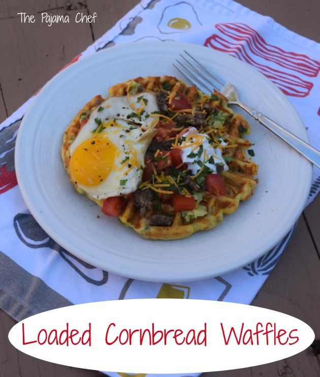 Cornbread waffles filled with cheese, peppers, and onions are loaded with sausage, tomatoes, a creamy avocado spread, and a fried egg for an impressive brunch like no other! This is a fantastic restaurant-worthy dish that's easy to make at home. You'll be sure to love it! #secretrecipeclub