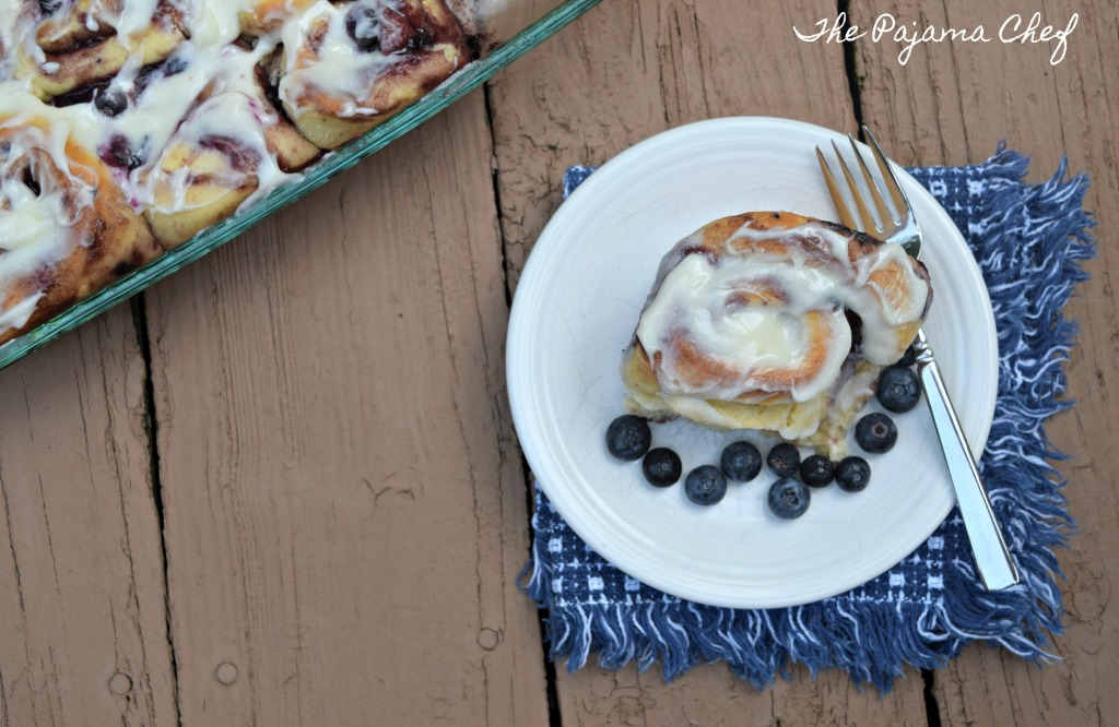 If you love cinnamon rolls, and you love blueberries, you NEED TO MAKE THIS RECIPE! Recipe for Blueberry Sweet Rolls on thepajamachef.com @thepajamachef