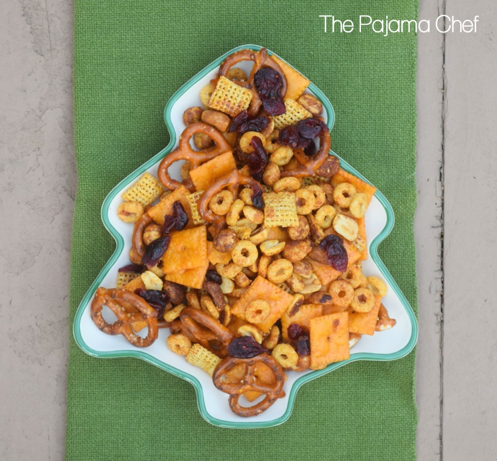 Sweet and spicy snack mix--a delightful blend of pretzels, honey roasted peanuts, cheese crackers, cereal, and dried cranberries. Everyone will love this addictive snack!